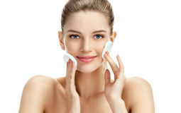 Free Charming Young Woman Cleaning Her Face With Cotton Pads. Royalty Free Stock Photos - 94656038
