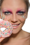 Charming young woman with donut in mouth Royalty Free Stock Photo