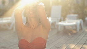 Charming young woman dressed in a bikini at sunset stock video footage