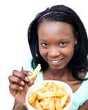 Charming young woman eating fries Royalty Free Stock Image
