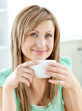 Charming young woman enjoyimg her coffee at home Royalty Free Stock Photo