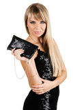 Charming young woman with fancy-bag. Charming young woman in black evening gown with fancy-bag Stock Photo