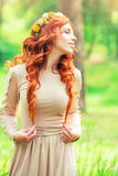 Charming young woman in the forest Royalty Free Stock Photos