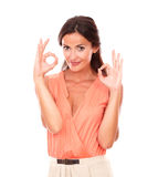 Charming young woman gesturing a great job Stock Photos