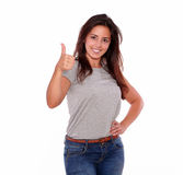 Charming young woman gesturing positive sign Royalty Free Stock Image