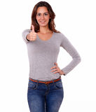 Charming young woman gesturing positive sign. Portrait of a charming young woman gesturing positive sign with fingers while standing on white background Stock Image