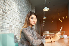Charming young woman have video conversation while breakfast in coffee shop stock images