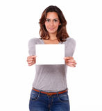 Charming young woman holding a blank card Stock Images