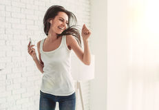 Charming young woman at home Stock Images