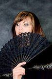 Charming young woman with italian fan Stock Image