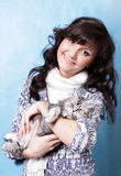 Charming young woman with kitten Royalty Free Stock Photography
