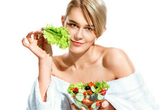Charming young woman with lettuce leaf Stock Photography