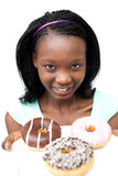 Charming young woman looking at donuts Royalty Free Stock Images