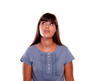 Charming young woman looking up on blue shirt Royalty Free Stock Photography