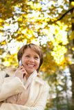 Charming young woman with mobile phone Royalty Free Stock Photo