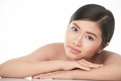 Charming young woman. Pensive charming young Asian woman with flawless skin looking at camera Royalty Free Stock Image