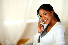 Charming young woman on phone looking at you Stock Photography