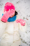 The charming young woman plays with someone in snowballs. Stock Images