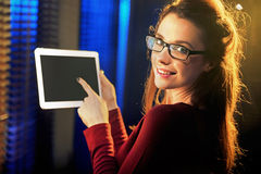 Charming young woman pointing a tablet Royalty Free Stock Photo
