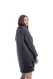 Charming young woman posing in gray woolen coat Stock Photos