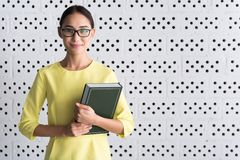 Charming young woman is posing with textbook stock photos