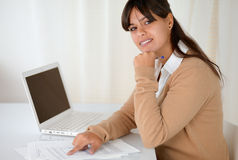 Charming young woman reading documents at office Stock Images