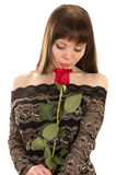 Charming young woman with a red rose Royalty Free Stock Photos