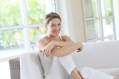 Charming young woman rsting on sofa at home Stock Photography