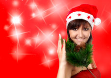Charming young woman in santa cap Royalty Free Stock Images