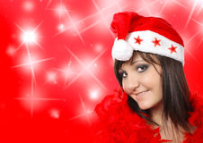 Charming young woman in santa cap Stock Image