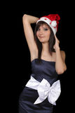 Charming young woman in santa cap Stock Images
