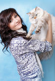 Charming young woman with Siberian cat Stock Photos