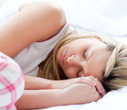 Charming young woman sleeping on a bed Stock Photography