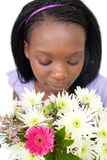 Charming young woman smelling flowers Royalty Free Stock Image