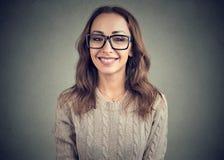 Charming young woman smiling at camera royalty free stock photography