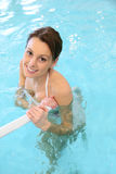 Charming young woman in a swimming pool Royalty Free Stock Photo