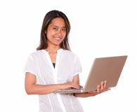 Charming young woman using her laptop computer Royalty Free Stock Photo