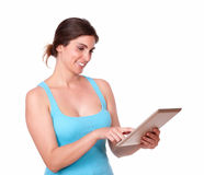 Charming young woman using tablet pc Royalty Free Stock Photo