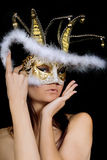 Charming young woman in venetian mask Stock Image