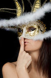 Charming young woman in venetian mask Royalty Free Stock Image