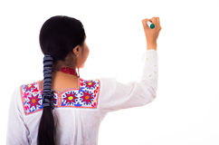 Charming young woman wearing traditional andean blouse with colorful embroideries, matching red necklace and earrings Stock Image
