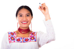 Charming young woman wearing traditional andean blouse with colorful embroideries, matching red necklace and earrings Royalty Free Stock Photography