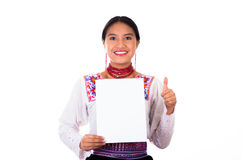 Charming young woman wearing traditional andean blouse with colorful embroideries, matching red necklace and earrings Royalty Free Stock Photos