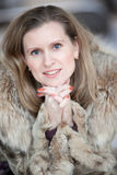 Charming young woman in a winter fur coat Royalty Free Stock Images