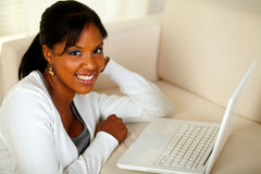 Charming young woman working on laptop Stock Photo