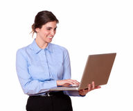 Charming young woman working on a laptop Royalty Free Stock Photo