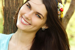 Charming young womanin spring forest Royalty Free Stock Photos