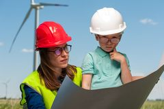 Concept of engineers and windmills stock images