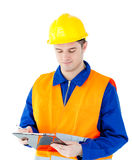Charming young worker writing on a clipboard Royalty Free Stock Photography