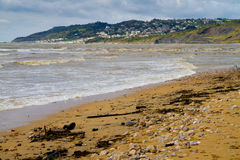 Charmouth beach in Dorset. It is located the mouth of the River Char overlooking Lyme Bay.  It is on the South West coastal path Stock Photography
